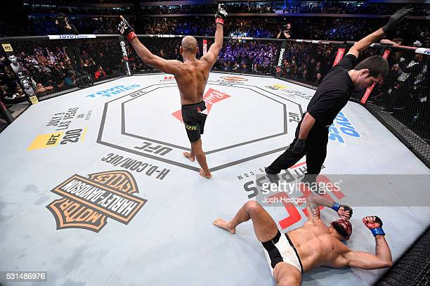 Ronaldo 'Jacare' Souza of Brazil celebrates after defeating Vitor Belfort of Brazil in their middleweight bout during the UFC 198 event at Arena da...