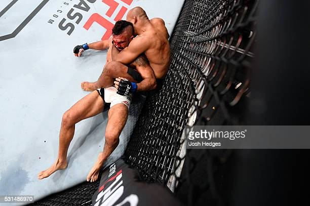 Ronaldo 'Jacare' Souza of Brazil controls the body of Vitor Belfort of Brazil in their middleweight bout during the UFC 198 event at Arena da Baixada...