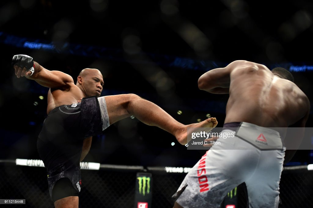 Ronaldo 'Jacare' Souza (L) of Brazil knocks down Derek Brunson in their middleweight bout during the UFC Fight Night event inside the Spectrum Center on January 27, 2018 in Charlotte, North Carolina.