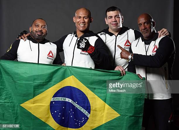 Ronaldo 'Jacare' Souza of Brazil poses with his team backstage during the UFC 198 event at Arena da Baixada stadium on May 14 2016 in Curitiba Parana...
