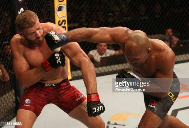 Ronaldo 'Jacare' Souza of Brazil punches Jan Blachowicz of Poland in their light heavyweight fight during the UFC Fight Night event at Ibirapuera...