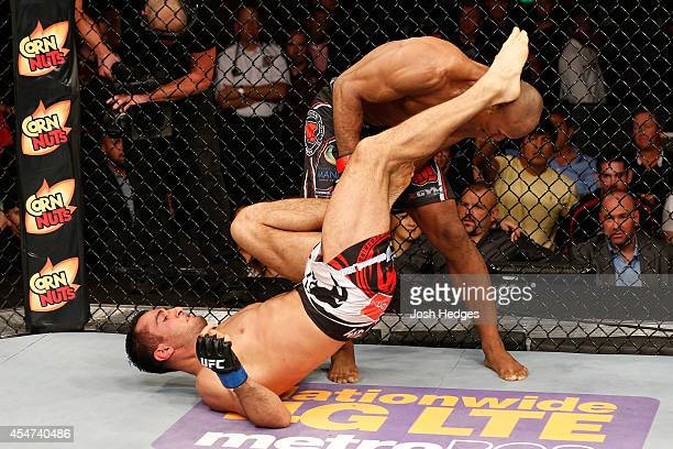 Ronaldo 'Jacare' Souza takes down Gegard Mousasi in their middleweight bout during the UFC Fight Night event at Foxwoods Resort Casino on September 5...