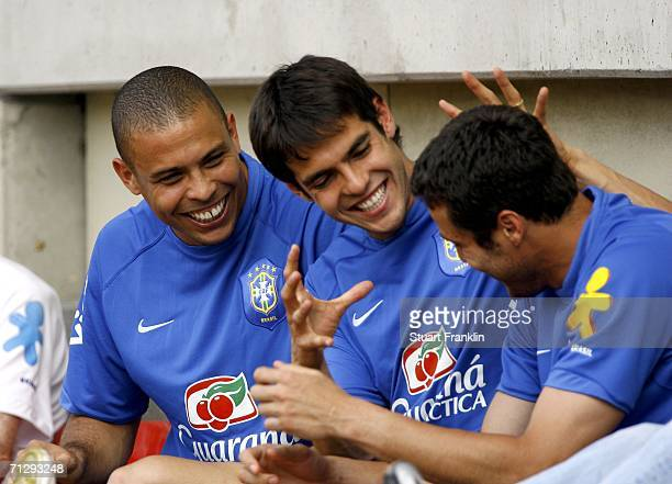 Ronaldo, Kaka and Julio Cesar of Brazil share a joke during the Brazil National Football Team training session for the FIFA World Cup Germany 2006 at...