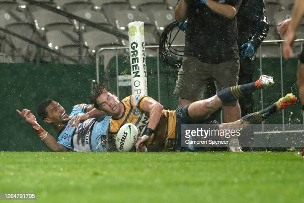 Ronaldo Mulitalo of the Sharks celebrates scoring a try during the round 13 NRL match between the Cronulla Sharks and the Parramatta Eels at...