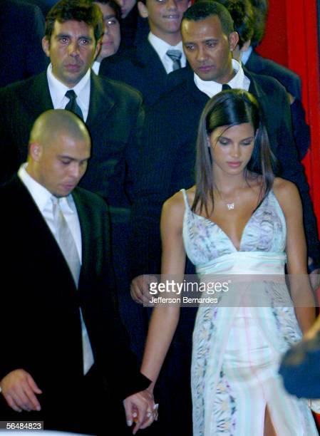 Ronaldo Nazario and his new girlfriend Raica de Oliveira attend the wedding of Brazilan soccer player Ricardo Izecson dos Santos Leite also known as...