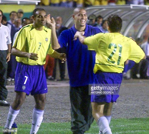 Ronaldo Nazario is seen with Ronaldinho hugs teammate Luizao of the brazilian soccer team 27 March 2002 during the friendly game against Yogoslavia...