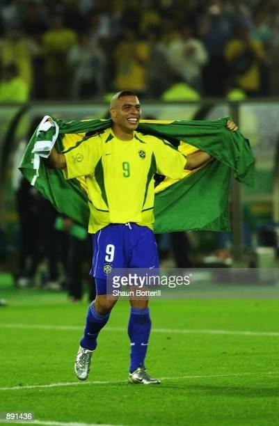 Ronaldo of Brazil celebrates after scoring both goals during the World Cup Final match against Germany played at the International Stadium Yokohama,...