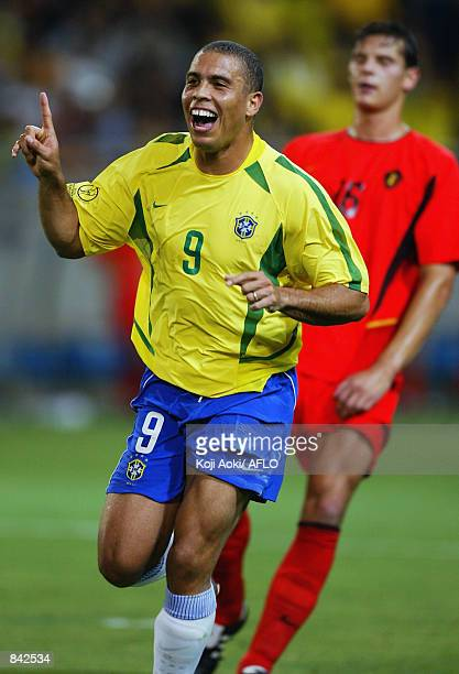 Ronaldo of Brazil celebrates after scoring the second goal during the FIFA World Cup Finals 2002 Second Round match between Brazil and Belgium played...