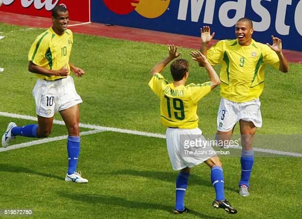Ronaldo of Brazil celebrates scoring his team's first goal with his team mate Juninho Paulista during the FIFA World Cup Korea/Japan Group C match...