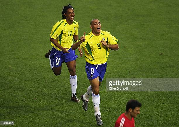 Ronaldo of Brazil celebrates scoring the equalising goal against Turkey with team mate Ronaldinho during the Group C match of the World Cup Group...