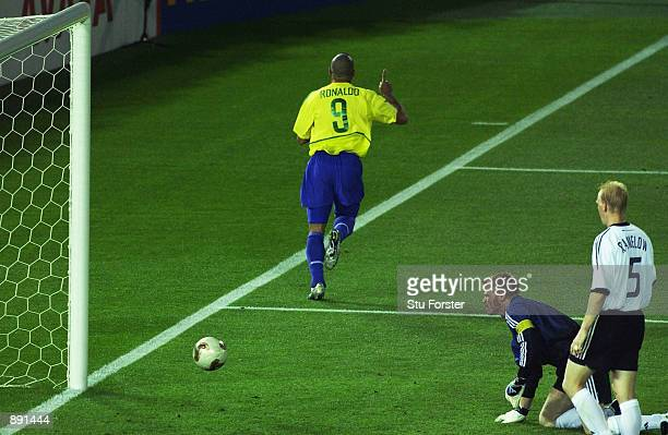Ronaldo of Brazil celebrates scoring the first goal past goalkeeper Oliver Kahn of Germany during the World Cup Final match played at the...