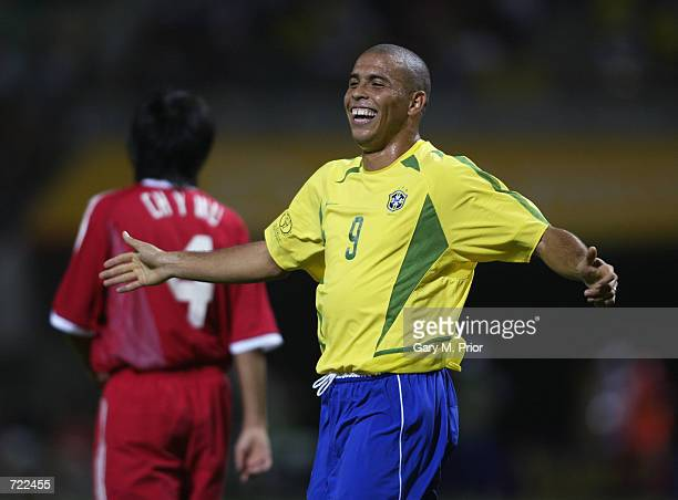 Ronaldo of Brazil celebrates scoring the fourth goal during the FIFA World Cup Finals 2002 Group C match between Brazil and China played at the...