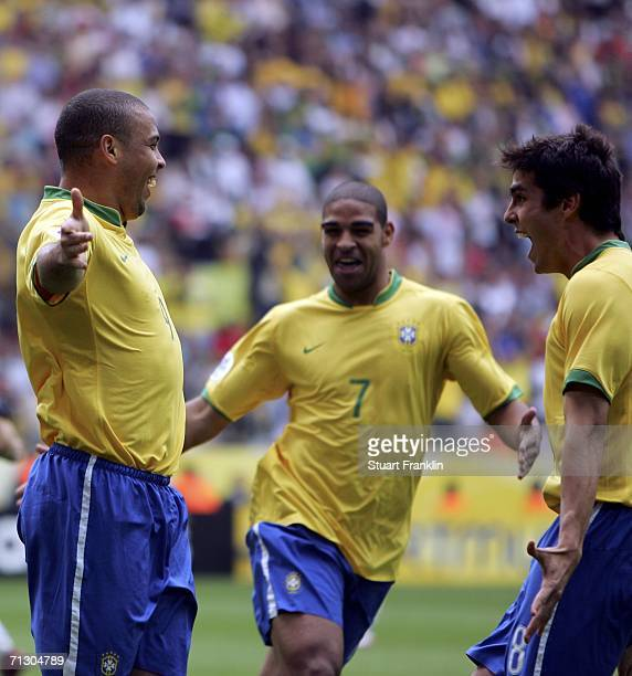 Ronaldo of Brazil celebrates with teammates Adriano and Kaka after scoring the opening goal during the FIFA World Cup Germany 2006 Round of 16 match...
