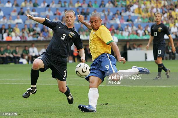Ronaldo of Brazil has a shot on goal as Craig Moore of Australia tries to block during the FIFA World Cup Germany 2006 Group F match between Brazil...