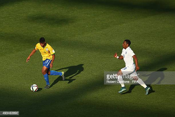 Ronaldo of Brazil is chased by Kaylen Hinds of England during the FIFA U17 World Cup Group B match between England and Brazil at Estadio La Portada...