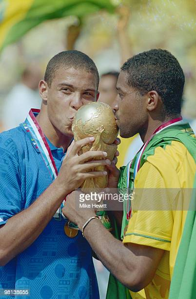 Ronaldo of Brazil kisses the trophy after winning the1994 FIFA World Cup Final against Italy on 17 July 1994 played at the Rose Bowl in Pasadena...