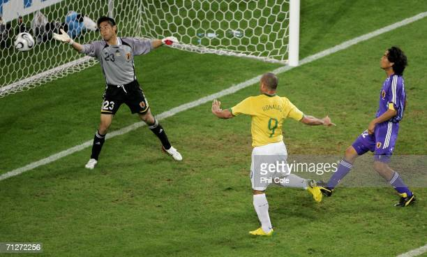Ronaldo of Brazil scores a headed goal as goalkeeper of Japan Yoshikatsu Kawaguchi fails to save during the FIFA World Cup Germany 2006 Group F match...