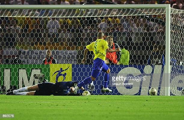 Ronaldo of Brazil scores his first goal past goalkeeper Oliver Kahn of Germany during the World Cup Final match played at the International Stadium...