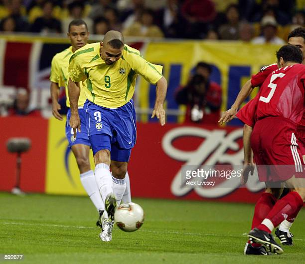 Ronaldo of Brazil scores the winning goal with an early shot during the FIFA World Cup Finals 2002 SemiFinal match between Brazil and Turkey played...