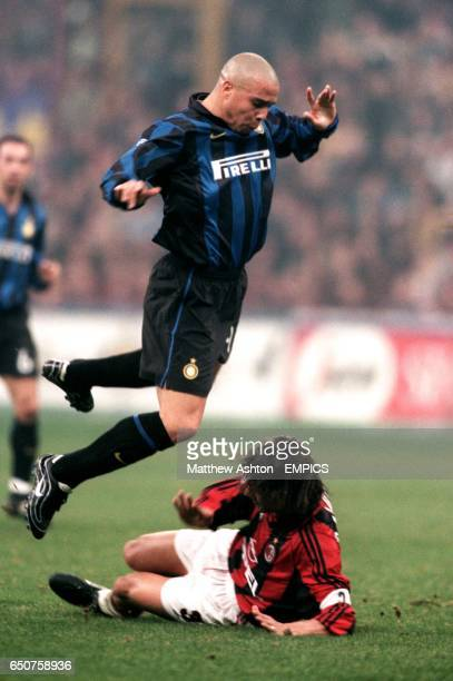 Ronaldo of INter jumps over Paolo Maldini of AC Milan