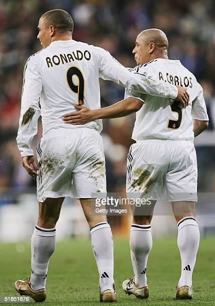 Ronaldo of Real Madrid celebrates with Roberto Carlos after scoring a goal against Real Sociedad during a Real Madrid v Real Sociedad Primera Liga...