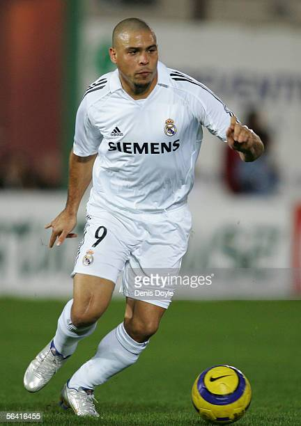 Ronaldo of Real Madrid dribbles the ball during a Primera Liga match between Malaga and Real Madrid on December 11 2005 at the Rosaleda stadium in...