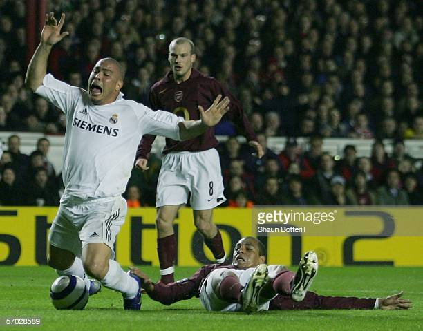 Ronaldo of Real Madrid is brought down by Gilberto of Arsenal during the UEFA Champions League Round of 16 Second Leg match between Arsenal and Real...