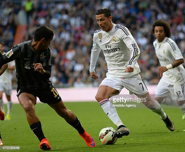 Ronaldo of Real Madrid is in action against Rosales of Malaga during the La Liga match between Real Madrid and Malaga at Estadio Santiago Bernabeu in...