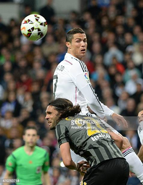Ronaldo of Real Madrid is in action against Sanchez during the La Liga match between Real Madrid and Malaga at Estadio Santiago Bernabeu in Madrid...