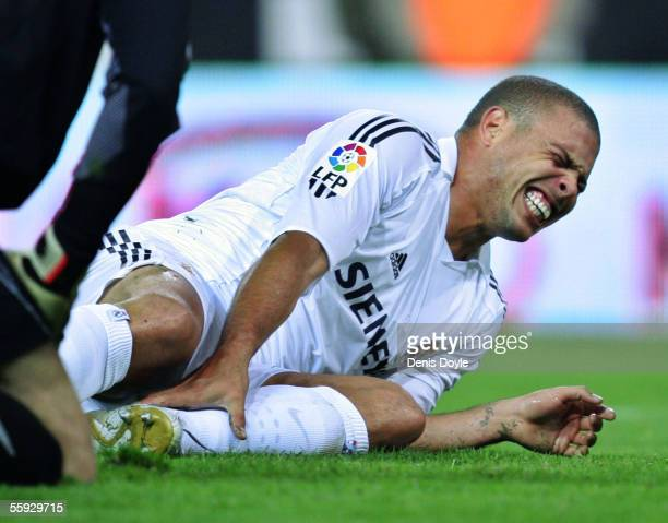 Ronaldo of Real Madrid reacts after getting injured while scoring his third goal against Atletico during a La Liga match between Atletico Madrid and...