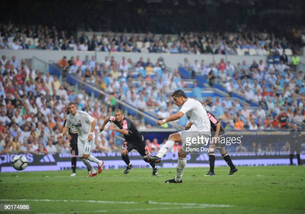 Ronaldo of Real Madrid scores a penalty goal during the La Liga match between Real Madrid and Deportivo La Coruna at the Santiago Bernabeu stadium on...
