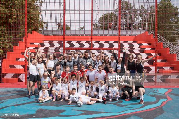 Ronaldo poses with Moscow youngsters at the opening of Box MSK at Gorky Park on June 12 2018 in Moscow Russia Brazil football icon Ronaldo and Russia...