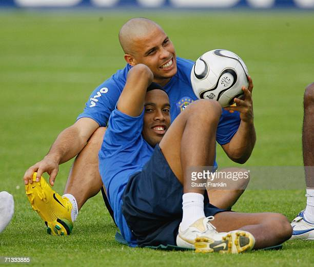 Ronaldo relaxes with Ronaldinho of Brazil during the Brazil National Football Team training session for the FIFA World Cup Germany 2006 at the...