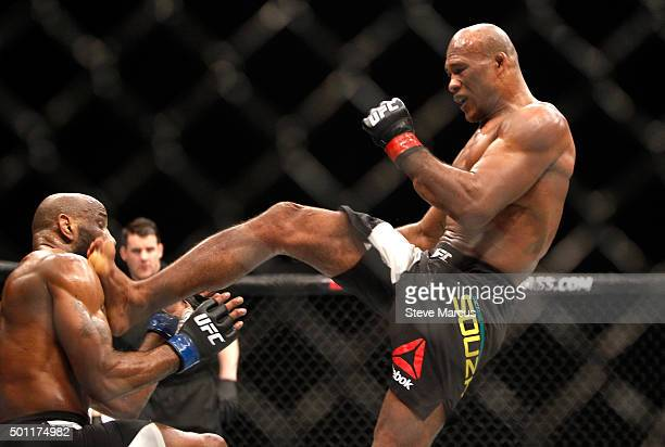 Ronaldo Souza kicks Yoel Romero in a middleweight fight during UFC 194 at MGM Grand Garden Arena on December 12 2015 in Las Vegas Nevada