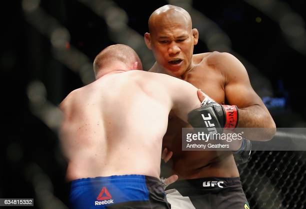 Ronaldo Souza of Brazil fights against Tim Boetsch of United States in the first round of their middleweight bout during UFC 208 at the Barclays...