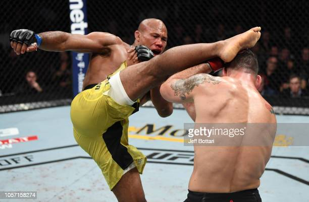 Ronaldo Souza of Brazil kicks Chris Weidman in their middleweight bout during the UFC 230 event inside Madison Square Garden on November 3 2018 in...