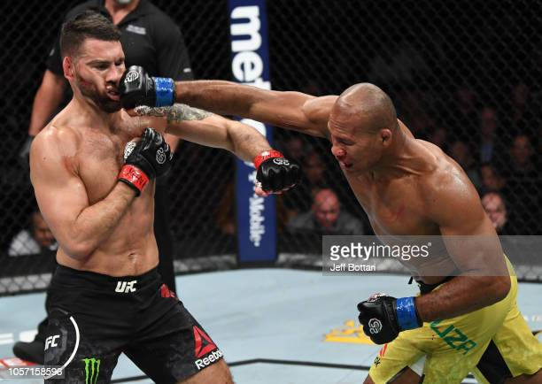 Ronaldo Souza of Brazil punches Chris Weidman in their middleweight bout during the UFC 230 event inside Madison Square Garden on November 3, 2018 in...