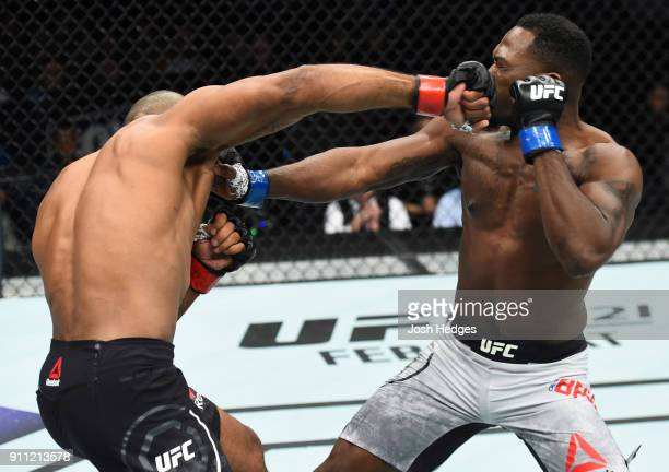 Ronaldo Souza of Brazil punches Derek Brunson in their middleweight bout during a UFC Fight Night event at Spectrum Center on January 27 2018 in...