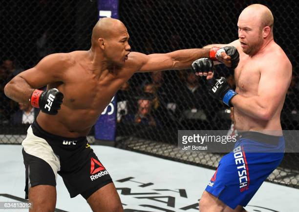 Ronaldo Souza of Brazil punches Tim Boetsch in their middleweight bout during the UFC 208 event inside Barclays Center on February 11 2017 in...