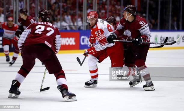Ronalds Kenins of Latvia skates against Peter Regin of Denmark during the 2018 IIHF Ice Hockey World Championship Group B game between Latvia and...