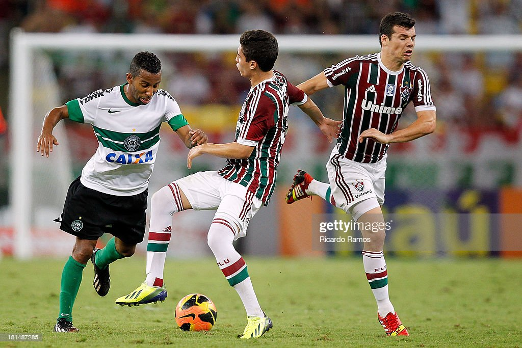 Ronan (C) and Wagner (R) of Fluminense fight for the ball with Vitor Junior of Coritiba during the match between Fluminense and Coritiba for the Brazilian Series A 2013 at Maracana on September 21, 2013 in Rio de Janeiro, Brazil.