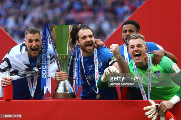 Ronan Curtis of Portsmouth celebrates with team mates and the trophy following victory the Checkatrade Trophy Final between Portsmouth and Sunderland...