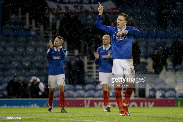 Ronan Curtis of Portsmouth FC acknowledges the return of home fans during the Sky Bet League One match between Portsmouth and Peterborough United at...