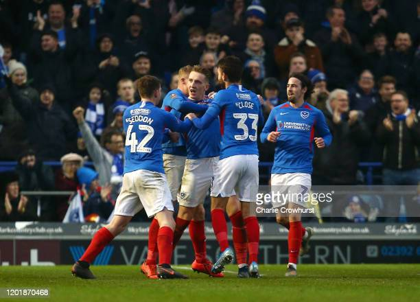 Ronan Curtis of Portsmouth FC celebrates with teammates after scoring his team's third goal during the FA Cup Fourth Round match between Portsmouth...
