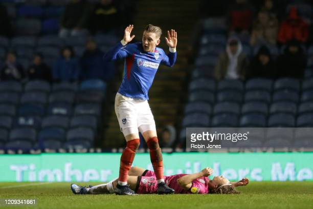 Ronan Curtis of Portsmouth FC knocks over Luke Matheson during the Sky Bet Leauge One match between Portsmouth and Rochdale at Fratton Park on...