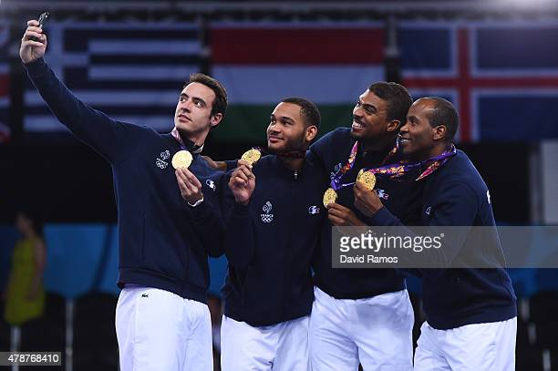 Ronan Gustin Jerel Dent Yannick Borel and Ivan Trevejo of France pose on the medal podium follwoing their win over Russia in the Men's Fencing Team...