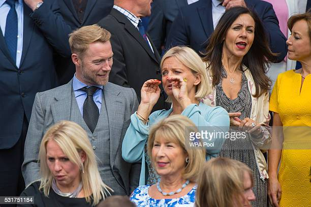 Ronan Keating and Alice Beer talk as celebrity award presenters pose for a group photograph during the Duke of Edinburgh Award's 60th Anniversary...