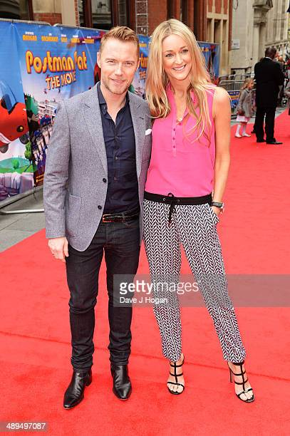 Ronan Keating and girlfriend Storm Keating attend the UK premiere of 'Postman Pat' at the Odeon West End on May 11 2014 in London England