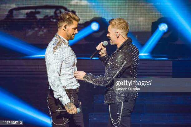 Ronan Keating and Keith Duffy of Boyzone perform on stage during The Final Five tour at the London Palladium on October 21 2019 in London England