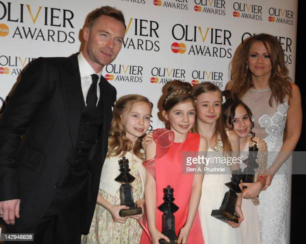 Ronan Keating and Kimberley Walsh pose with Sophia Kiely Eleanor Worthington Cox Kerry Ingram and Cleo Demetriou winners of Best Actress in a Musical...
